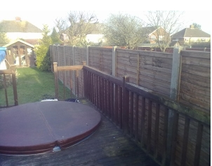 Brown orange dipped treated panels with concrete slotted posts