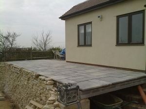 Raised patio built on a concrete block wall